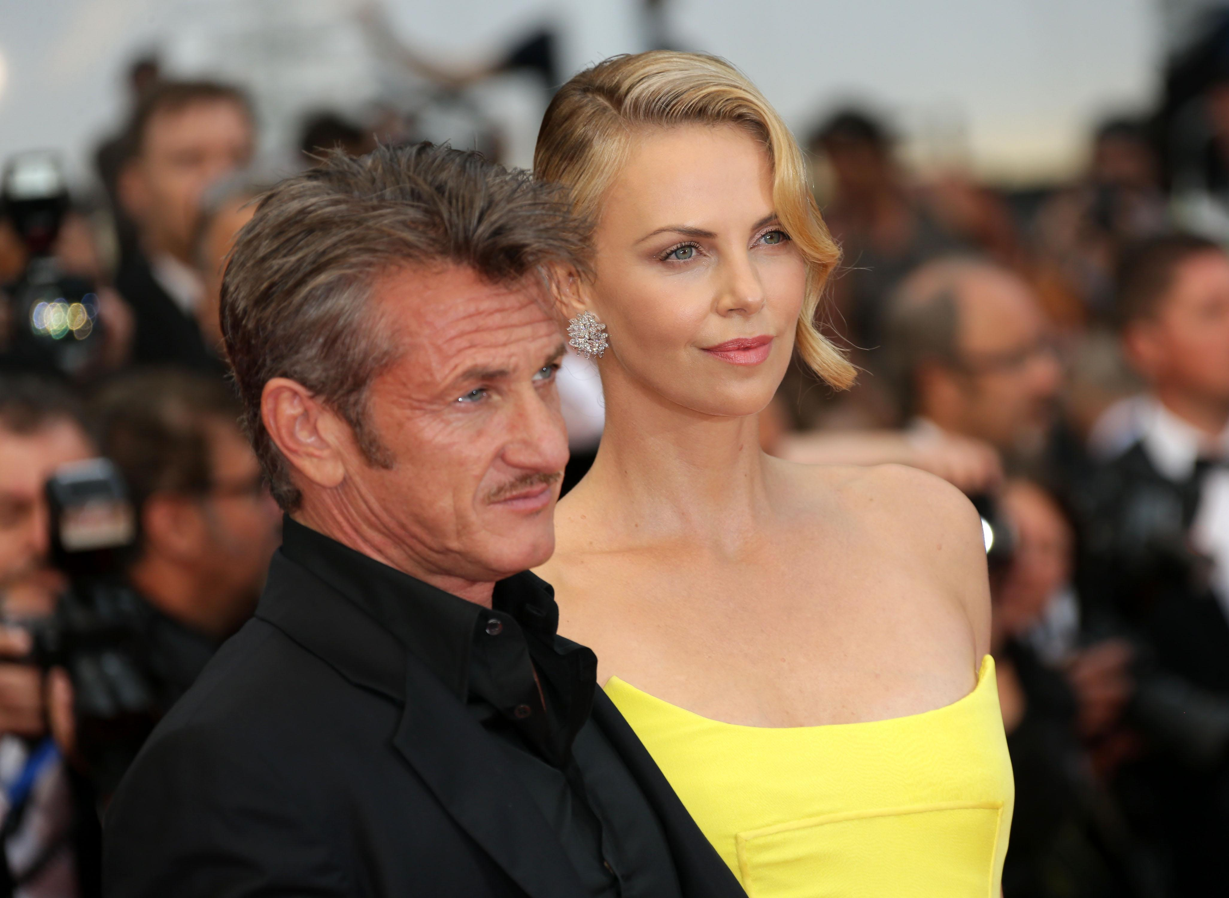 Sean Penn and Charlize Theron arrive for the screening of the film Mad Max: Fury Road at the 68th international film festival, Cannes, southern France, Thursday, May 14, 2015. (Photo by Joel Ryan/Invision/AP)