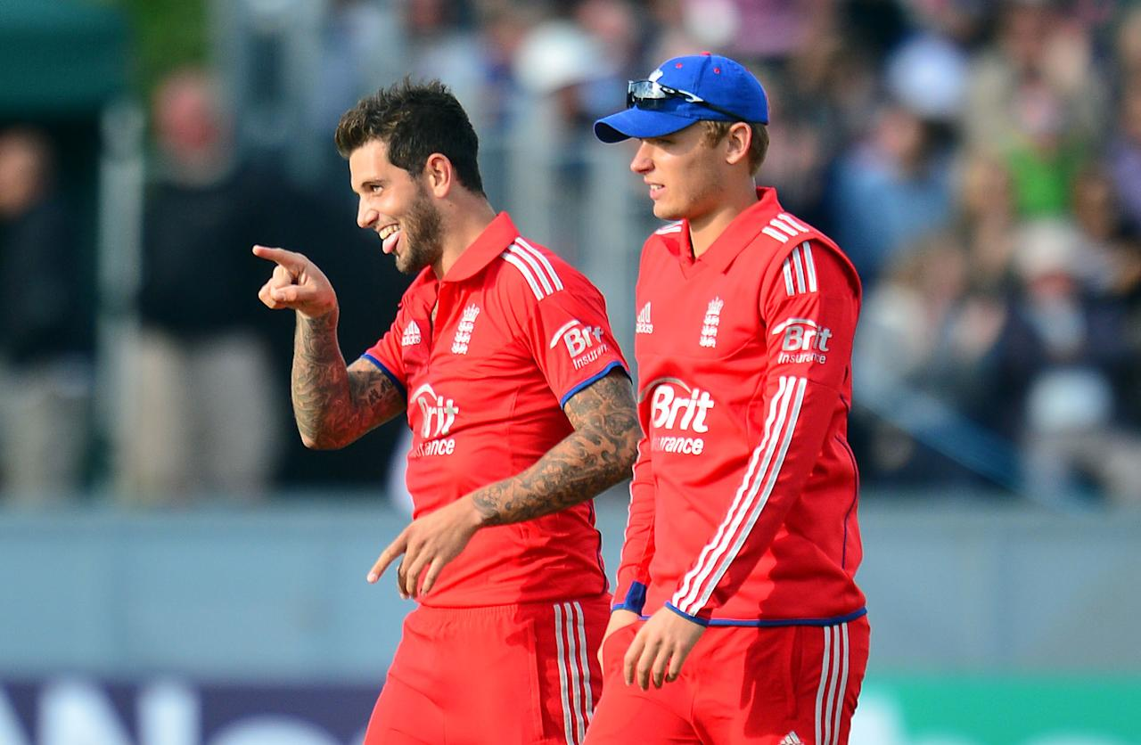 England's Jade Dernbach (left) celebrates the wicket of Glenn Maxwell with team mate Joe Root during the second NatWest International T20 at the Emirates Durham ICG, Durham.