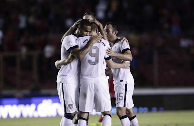 Aron Johannsson, center, of the U.S. celebrates with teammates after scoring a goal against Panama in a 2014 World Cup qualifying soccer match, in Panama City, Tuesday, Oct. 15, 2013. The United States rallied for a 3-2 win at Panama on Tuesday night that left Mexico's World Cup hopes alive and knocked out the Panamanians. (AP Photo/Arnulfo Franco)