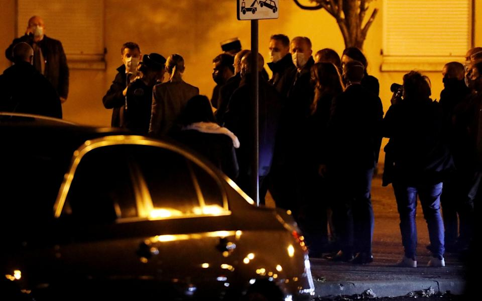 French President Emmanuel Macron arriving at the scene of the stabbing attack - Reuters