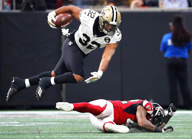<p>New Orleans Saints running back Jonathan Williams (32) leaps over Atlanta Falcons linebacker Duke Riley (42) during the first half of an NFL football game, Sunday, Sept. 23, 2018, in Atlanta. (AP Photo/David Goldman) </p>