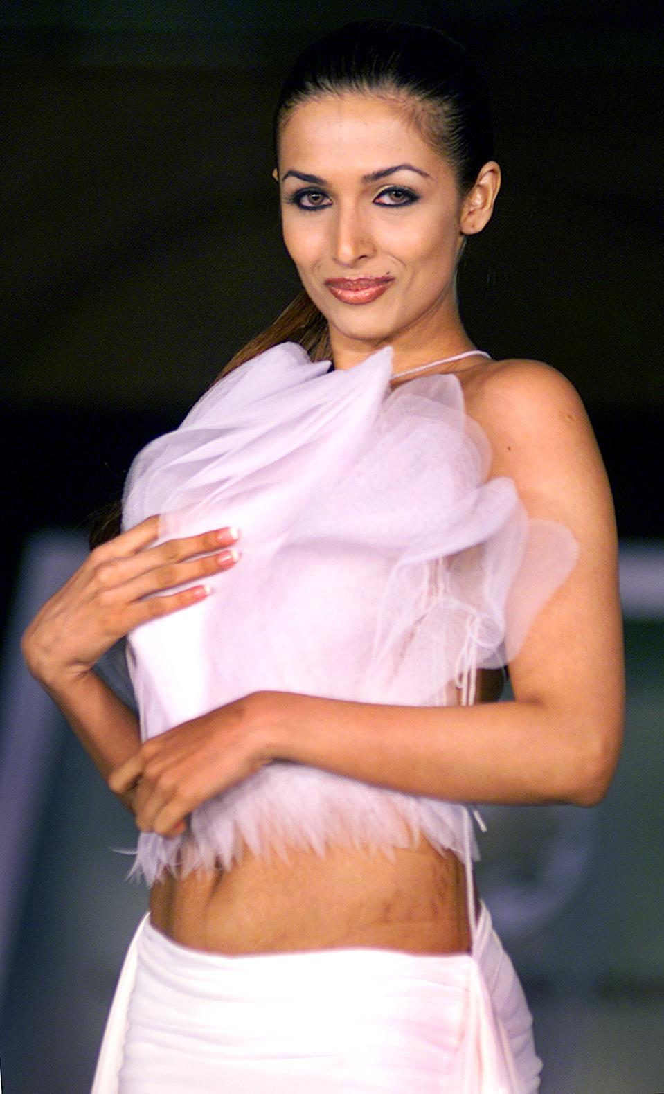 Bollywood actress Malaika displays a special collection during a fashion show organised by the Cancer Patients Aid Association (CPA) in Bombay May 31, 2003. The show was organised on 'World No Tobacco Day' to create awareness in Bollywood against portraying film stars smoking in movies. A World Health Organization (WHO) study on Indian films showed 80% of them depicted the use of tobacco. REUTERS/Roy Madhur RM/TW