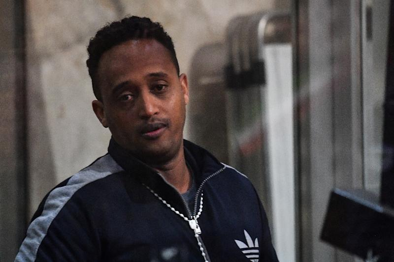 The man believed to be Eritrean Medhanie Yehdego Mered, on trial as the alleged head of one of the largest migrant trafficking networks, says his case is one of mistaken identity and he is really a carpenter called Medhanie Tesfamariam Behre