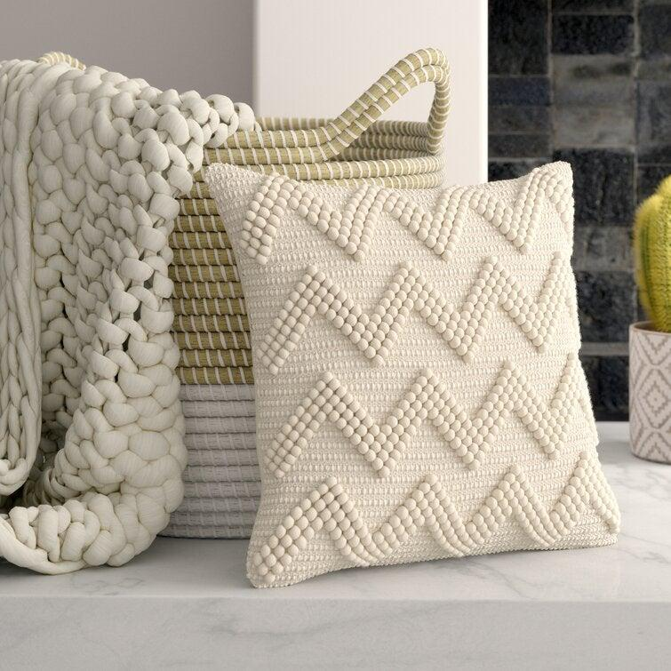 """Pair a neutral with some unexpected texture for a color palette that's serene, but far from boring. <br><br><strong>Mistana</strong> Coletta Square Pillow Cover and Insert, $, available at <a href=""""https://go.skimresources.com/?id=30283X879131&url=https%3A%2F%2Fwww.wayfair.com%2Fdecor-pillows%2Fpdp%2Fmistana-coletta-square-pillow-cover-and-insert-w005405556.html"""" rel=""""nofollow noopener"""" target=""""_blank"""" data-ylk=""""slk:Wayfair"""" class=""""link rapid-noclick-resp"""">Wayfair</a>"""