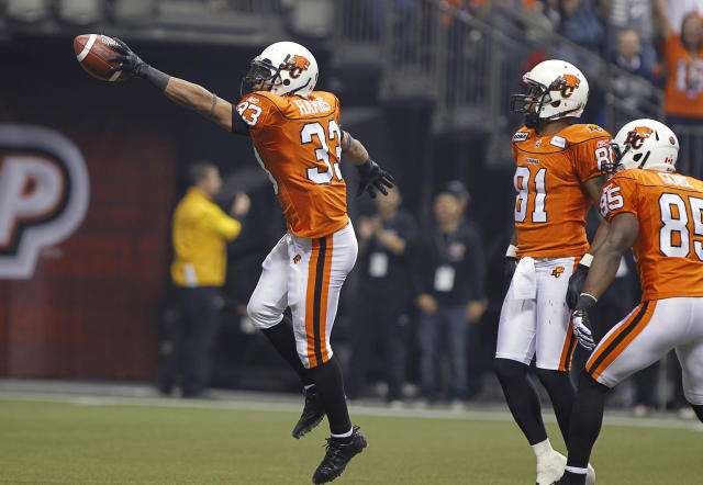 VANCOUVER, CANADA - NOVEMBER 27: Andrew Harris #33, Geroy Simon #81 and Shawn Gore #85 of the BC Lions celebrate the opening touchdown against the Winnipeg Blue Bombers during the CFL 99th Grey Cup November 27, 2011 at BC Place in Vancouver, British Columbia, Canada. (Photo by Jeff Vinnick/Getty Images)