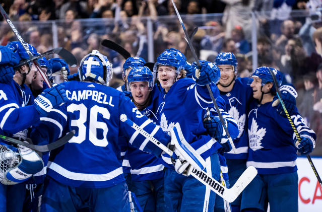 TORONTO, ON - FEBRUARY 11: Kasperi Kapanen #24 of the Toronto Maple Leafs celebrates with teammate Jack Campbell #36 after scoring the game winning goal in overtime against the Arizona Coyotes at the Scotiabank Arena on February 11, 2020 in Toronto, Ontario, Canada. (Photo by Kevin Sousa/NHLI via Getty Images)