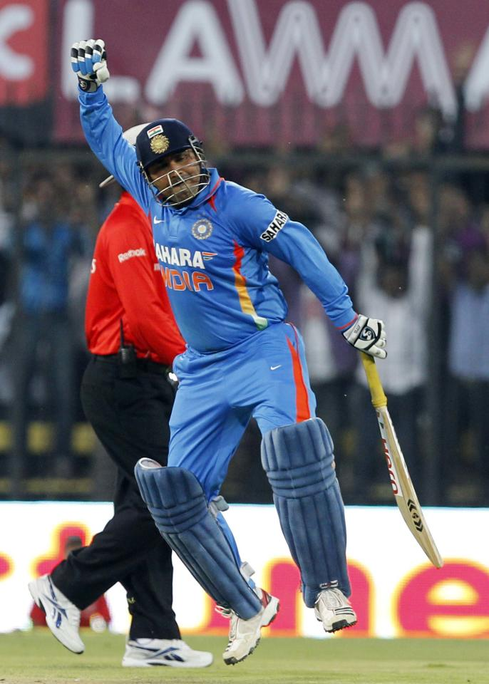 INDORE, INDIA - DECEMBER 8: Virender Sehwag of India pumps his fist in joy after scoring a double hundred during the 4th One Day International between India and West Indies at Holkar Stadium on December 8, 2011 in Indore, India. (Photo by Santosh Harhare/Hindustan Times via Getty Images).