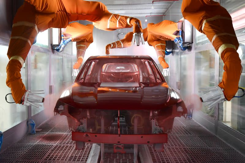 Robotic arms paint a car at the BYD Automobile Company Limited Xi'an plant, in Shaanxi