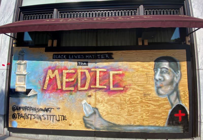 A mural adorns wall of a restaurant on Black Lives Matter Plaza in Washington