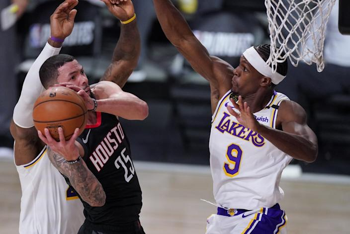 Lakers guard Rajon Rondo forces Rockets guard Austin Rivers into an awkward shot with his defense on Sept. 8, 2020.