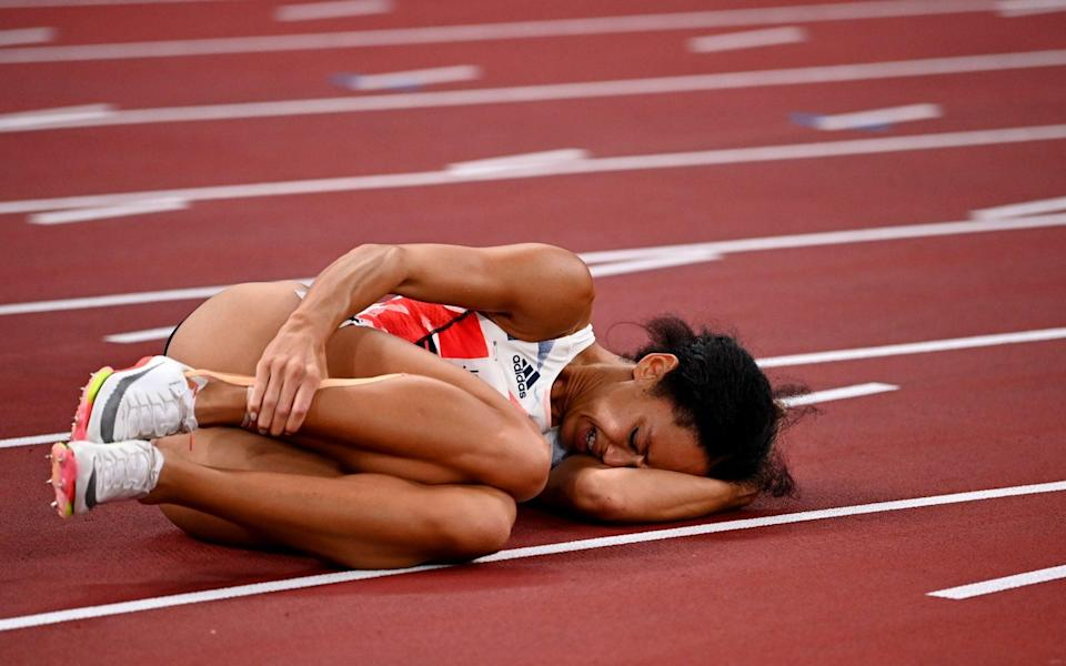 Johnson-Thompson lies crumpled on the track - REUTERS