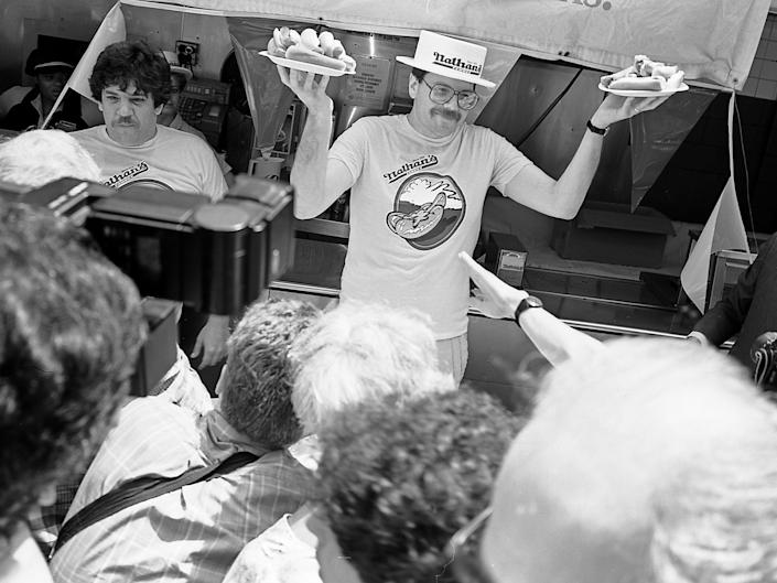 Contestants at the Nathan's Hot Dog Eating Contest at Coney Island, July 4, 1987.