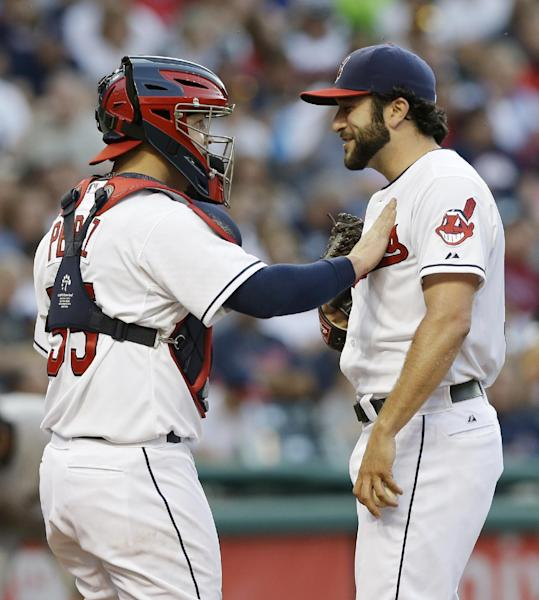 Cleveland Indians starting pitcher T.J. House, right, and catcher Roberto Perez talk during the fourth inning of a baseball game Thursday, July 10, 2014, in Cleveland. (AP Photo/Tony Dejak)