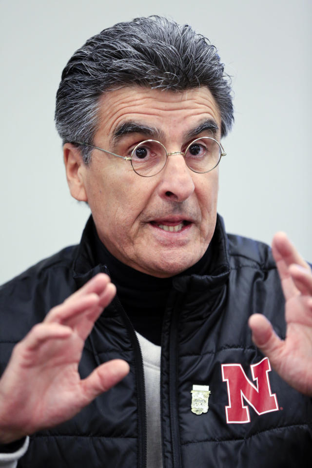 Nebraska NCAA college football quarterbacks coach Mario Verduzco talks to reporters following a news conference in Lincoln, Neb., Wednesday, March 14, 2018. The biggest question head coach Scott Frost faces as he enters spring practice: Who'll play quarterback? Patrick O'Brien, Tristan Gebbia and incoming freshman Adrian Martinez all are being given an equal chance to win the job. (AP Photo/Nati Harnik)