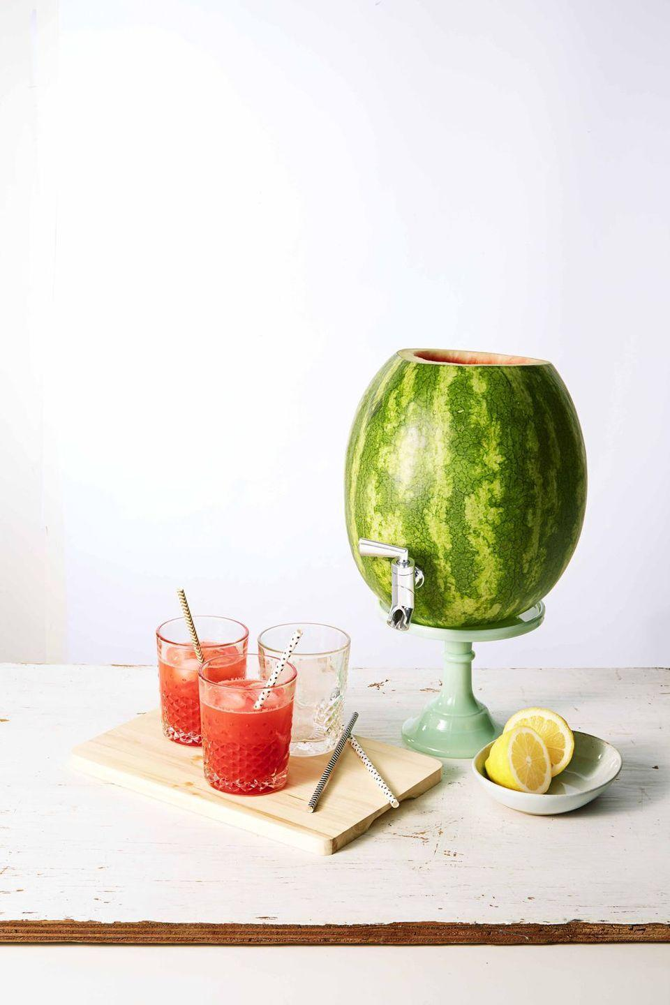 """<p>This keg is decoration and drink all in one: Once hollowed, add the drink of your choice — alcoholic or otherwise — and let party guests serve themselves. </p><p><em><a href=""""https://www.goodhousekeeping.com/food-recipes/how-to/a23788/how-to-make-a-watermelon-keg/"""" rel=""""nofollow noopener"""" target=""""_blank"""" data-ylk=""""slk:Get the tutorial for Watermelon Keg »"""" class=""""link rapid-noclick-resp"""">Get the tutorial for Watermelon Keg »</a></em></p><p><strong>RELATED:</strong> <a href=""""https://www.goodhousekeeping.com/holidays/tips/g3620/summer-party/"""" rel=""""nofollow noopener"""" target=""""_blank"""" data-ylk=""""slk:60 Genius Summer Party Ideas for Easy Entertaining"""" class=""""link rapid-noclick-resp"""">60 Genius Summer Party Ideas for Easy Entertaining</a><br></p>"""