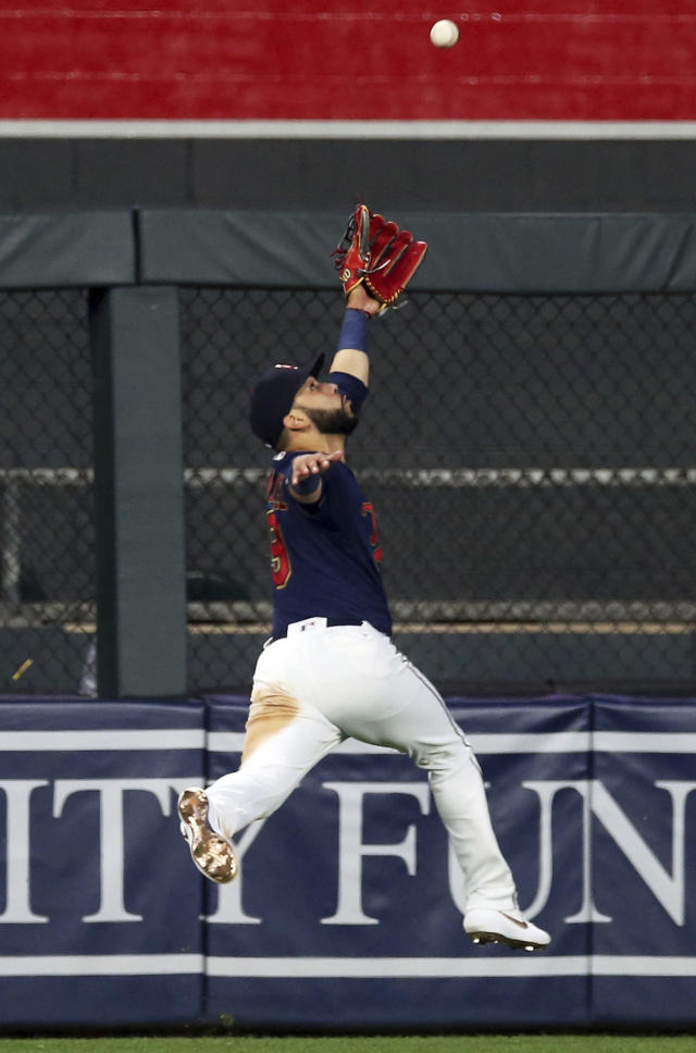 Minnesota Twins center fielder Marwin Gonzalez jumps but can't make the catch on a double by Milwaukee Brewers' Ryan Braun in the seventh inning of a baseball game, Tuesday, May 28, 2019, in Minneapolis. (AP Photo/Jim Mone)