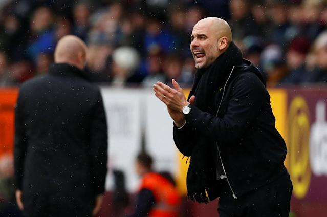 "Soccer Football - Premier League - Burnley vs Manchester City - Turf Moor, Burnley, Britain - February 3, 2018 Manchester City manager Pep Guardiola reacts Action Images via Reuters/Jason Cairnduff EDITORIAL USE ONLY. No use with unauthorized audio, video, data, fixture lists, club/league logos or ""live"" services. Online in-match use limited to 75 images, no video emulation. No use in betting, games or single club/league/player publications. Please contact your account representative for further details."