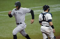 New York Yankees' Aaron Judge, left, scores past Tampa Bay Rays catcher Mike Zunino (10) on a sacrifice fly by Aaron Hicks during the seventh inning of a baseball game Wednesday, May 12, 2021, in St. Petersburg, Fla. (AP Photo/Chris O'Meara)