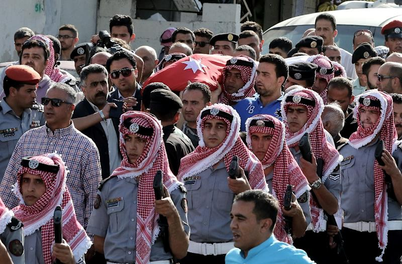 Jordanian mourners carry the body of intelligence corporal Omar al-Hayari, one of the  five Jordanian intelligence agents killed during a gun attack at the Palestinian refugee camp of Baqaa, on June 6, 2016