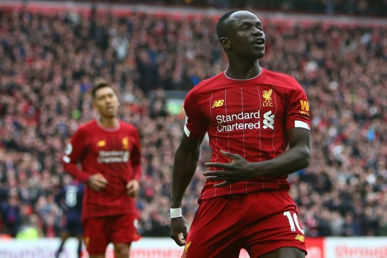 Liverpool's Senegalese striker Sadio Mane (R) has donated $50000 US dollars to the Coronavirus fight in gis country