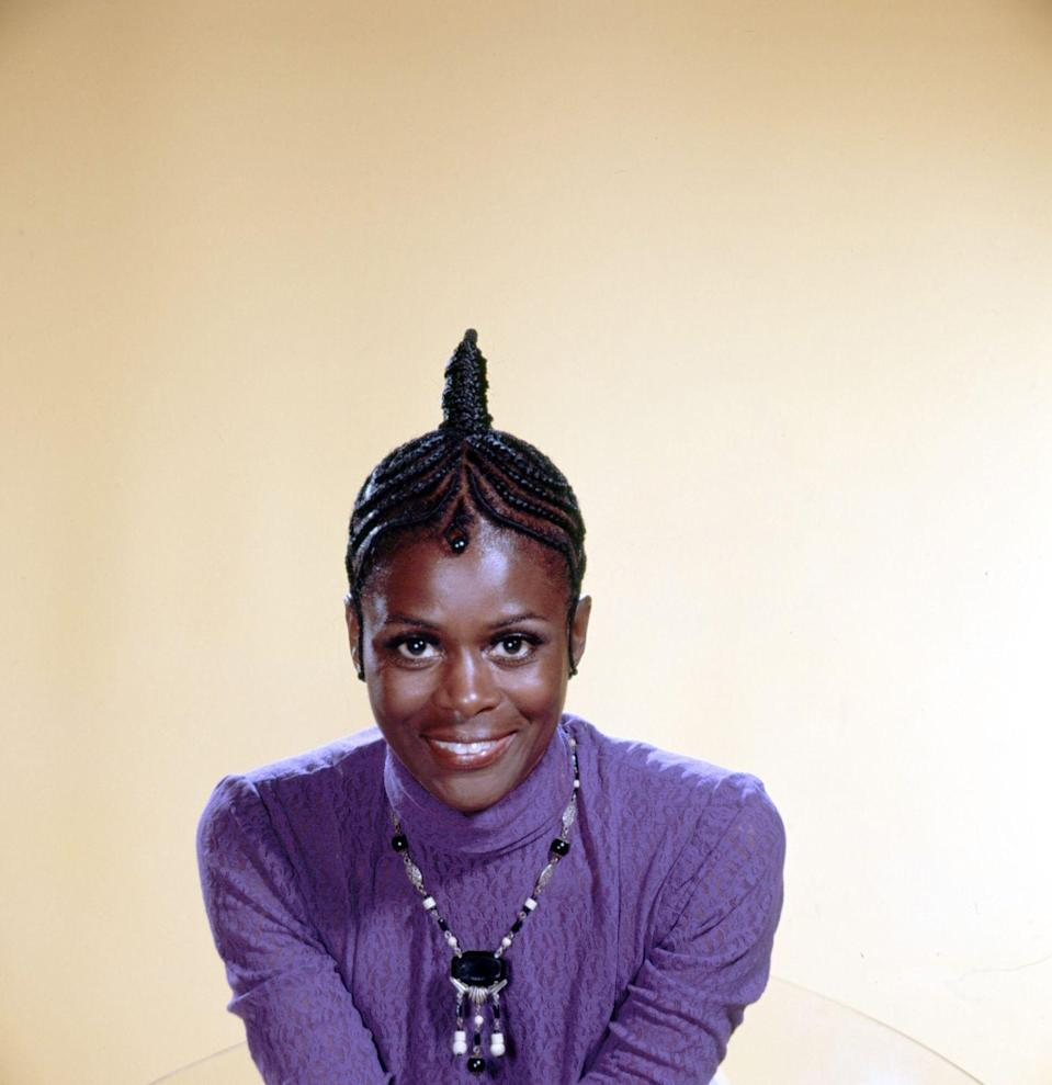 <p>Cicely faces the camera straight on while wearing one of her signature cornrow styles. </p>