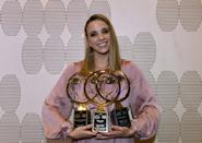 <p>Smith has been making major waves for the past few years, bringing home the hardware from competitions and organizations all over the swim world. In 2019, she took home three Golden Goggle awards for Breakout Performer of the Year, Female Race of the Year, and Relay Performance of the Year. She's also won two world gold medals and an array of medals at other major competitions over the course of her career, and she's just getting started!</p>