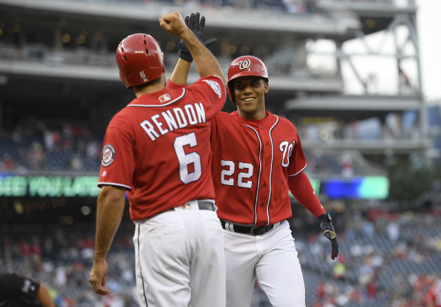 Washington Nationals' Juan Soto (22) celebrates his two-run home run with Anthony Rendon (6) during the sixth inning of the continuation of a suspended baseball game against the New York Yankees, Monday, June 18, 2018, in Washington. This game is a continuation of a suspended game from May 15. (AP Photo/Nick Wass)