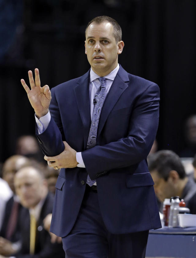 Indiana Pacers coach Frank Vogel calls a play for his team during the first half of the Pacers' NBA basketball game against the New York Knicks in Indianapolis, Thursday, Jan. 16, 2014. (AP Photo/Michael Conroy)