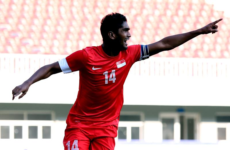 NAY PYI TAW, BURMA - DECEMBER 21: Hariss Harun of Singapore celebrates after scoring a goal against Malaysia during the Men's 3rd placing play-off Football Competition match between Singapore and Malaysia during the 2013 SEA Games at the Zeyar Thiri Stadium on December 21, 2013 in Nay Pyi Taw, Burma. (Photo by Stanley Chou/Getty Images)