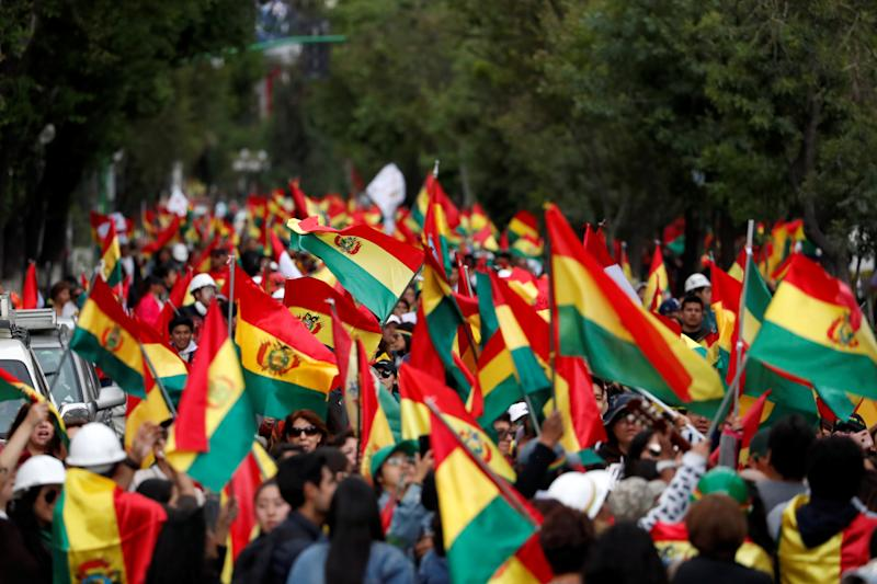 People wave national flags during a protest against Bolivia's President Evo Morales in La Paz, Bolivia November 10, 2019. REUTERS/Carlos Garcia Rawlins