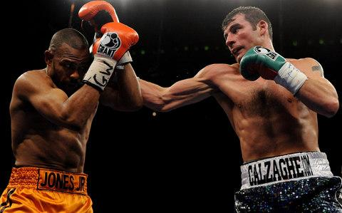 Jones Jr shields himself from a Calzaghe punch - Credit: Getty Images