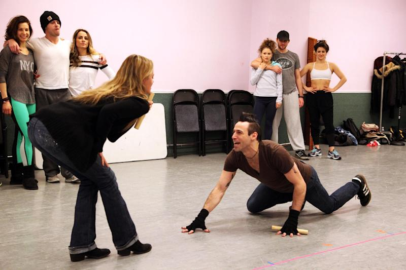 "In this Tuesday, Jan. 28, 2014 photo, Kate Rockwell, left, and Joey Calveri rehearse a scene from ""Rock of Ages"" at a dance studio in New York. The cast of the Broadway show will be part of the televised pregame entertainment from outside MetLife Stadium in New Jersey for Sunday's Super Bowl. (AP Photo/Mark Kennedy)"