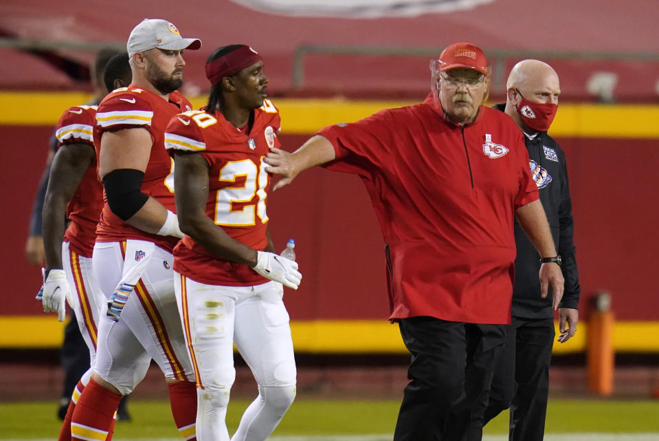 Kansas City Chiefs head coach Andy Reid, right, walks off the field with cornerback Antonio Hamilton (20) after an NFL football game against the New England Patriots, Monday, Oct. 5, 2020, in Kansas City. The Chiefs won 26-10. (AP Photo/Jeff Roberson)