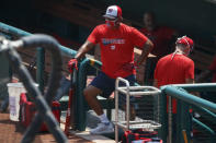 Washington Nationals' manager David Martinez looks out from the dugout during a baseball training camp workout at Nationals Stadium, Sunday, July 5, 2020, in Washington. (AP Photo/Carolyn Kaster)