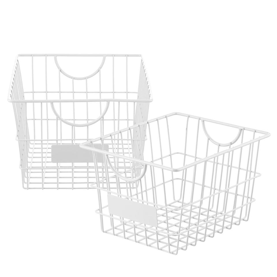 "<p>You can easily label these <a href=""https://www.popsugar.com/buy/White-Wire-Storage-Baskets-496377?p_name=White%20Wire%20Storage%20Baskets&retailer=containerstore.com&pid=496377&price=5&evar1=casa%3Aus&evar9=46697047&evar98=https%3A%2F%2Fwww.popsugar.com%2Fhome%2Fphoto-gallery%2F46697047%2Fimage%2F46700079%2FWhite-Wire-Storage-Baskets&list1=shopping%2Corganization%2Ckitchens%2Chome%20organization&prop13=api&pdata=1"" rel=""nofollow"" data-shoppable-link=""1"" target=""_blank"" class=""ga-track"" data-ga-category=""Related"" data-ga-label=""https://www.containerstore.com/s/white-wire-storage-baskets-with-handles/d?q=pantry%20organizer&amp;productId=11011789"" data-ga-action=""In-Line Links"">White Wire Storage Baskets</a> ($5-$7).</p>"