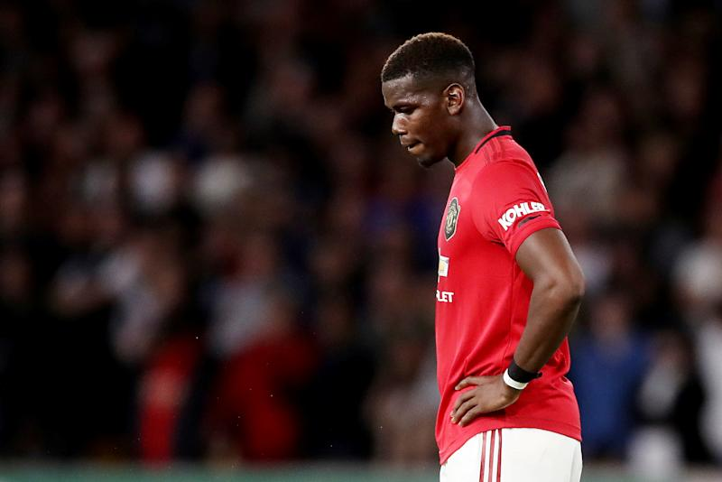 """Soccer Football - Premier League - Wolverhampton Wanderers v Manchester United - Molineux Stadium, Wolverhampton, Britain - August 19, 2019 Manchester United's Paul Pogba reacts during the match Action Images via Reuters/Carl Recine EDITORIAL USE ONLY. No use with unauthorized audio, video, data, fixture lists, club/league logos or """"live"""" services. Online in-match use limited to 75 images, no video emulation. No use in betting, games or single club/league/player publications. Please contact your account representative for further details."""