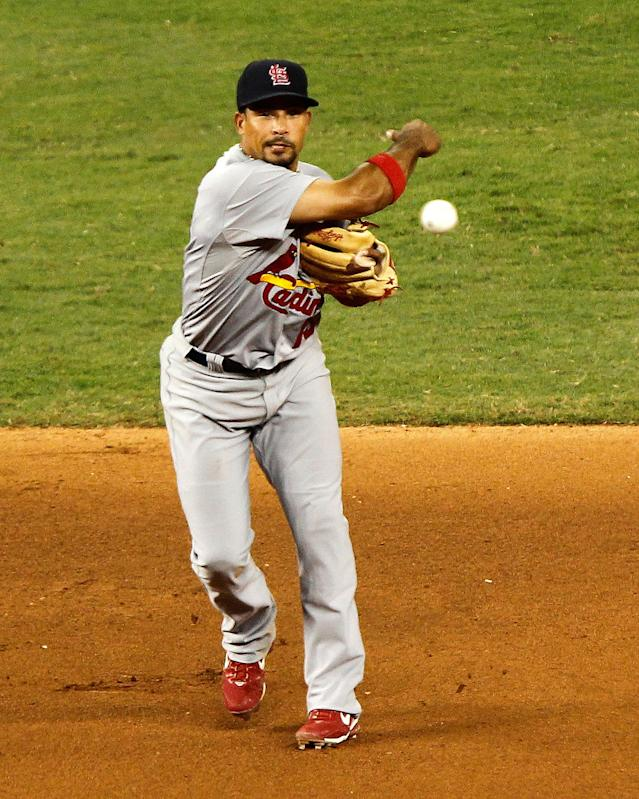 MIAMI, FL - JUNE 26: Rafael Furcal #15 of the St. Louis Cardinals makes a throw to first during a game against the Miami Marlins at Marlins Park on June 26, 2012 in Miami, Florida. (Photo by Mike Ehrmann/Getty Images)