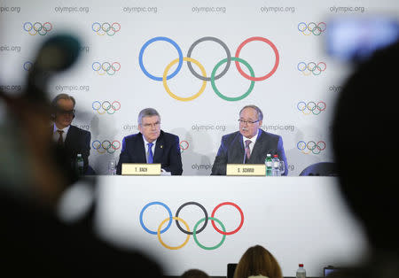 Samuel Schmid, Chair of the IOC Disciplinary Commission, and Thomas Bach, President of the International Olympic Committee, attend a news conference after an Executive Board meeting on sanctions for Russian athletes, in Lausanne, Switzerland, December 5, 2017. REUTERS/Denis Balibouse