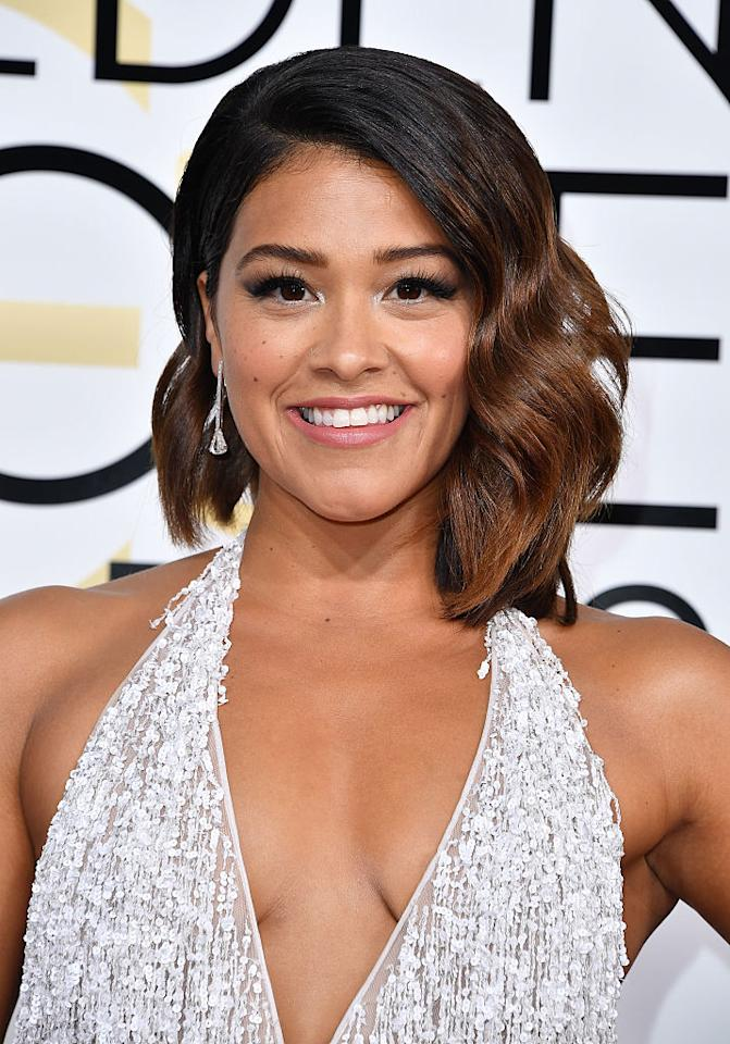 <p>Gina Rodriguez is gorgeous with a gentle mix of black and bronze strands. </p>
