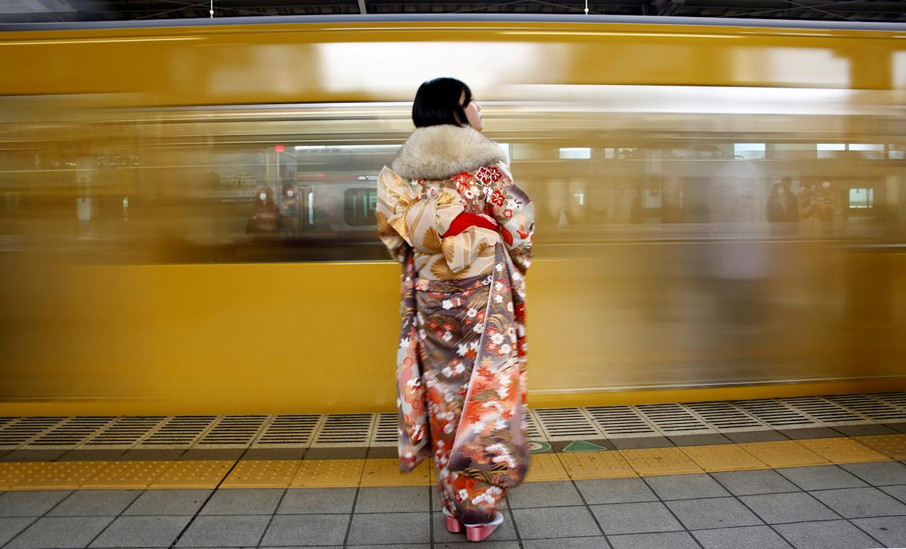 FILE PHOTO: A Japanese woman wearing a kimono waits for her train after Coming of Age Day celebration ceremony in Tokyo, Japan January 9, 2017. REUTERS/Kim Kyung-Hoon/File Photo