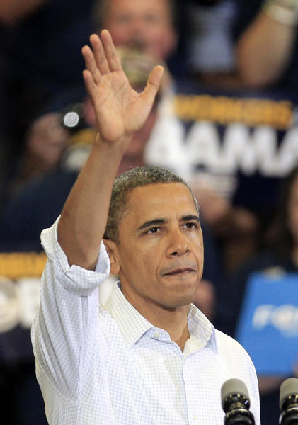 President Barack Obama waves to supporters after speaking at a campaign event at Scott High School Monday, Sept. 3, 2012, in Toledo, Ohio. (AP Photo/Tony Dejak)