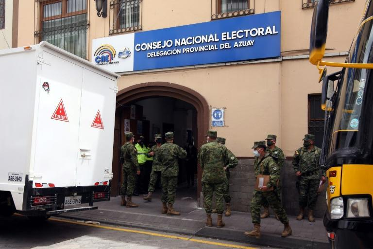 Ecuadorian soldiers carry electoral materials for the upcoming general election at the National Electoral Council of Azuay, in Cuenca, Ecuador