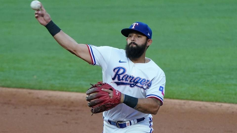 Rougned Odor throwing Rangers white jersey