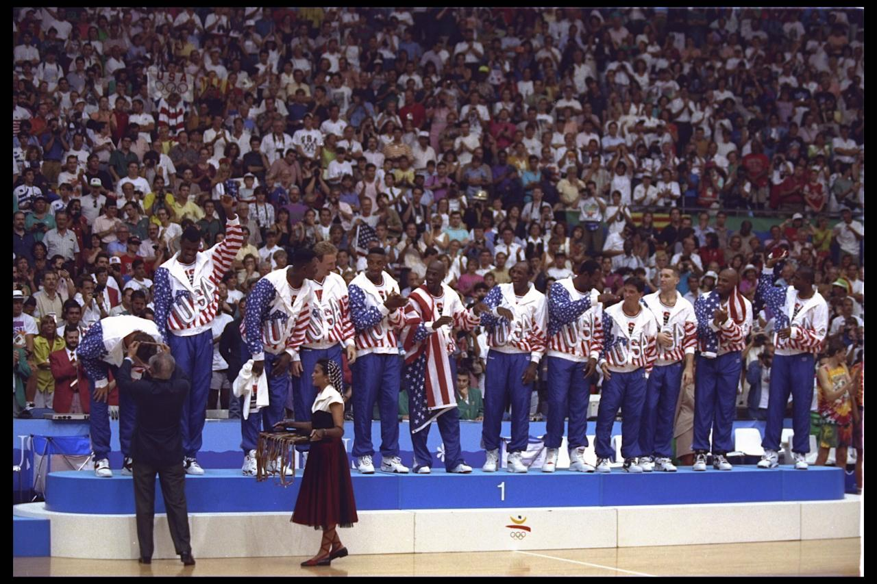 8 Aug 1992:  Christian Laettner of the USA Dream Team bends over to receive his gold medal during the medal ceremony following the basketball finals in the 1992 Summer Olympics in Barcelona, Spain.  Mandatory Credit:  Mike Powell/Allsport