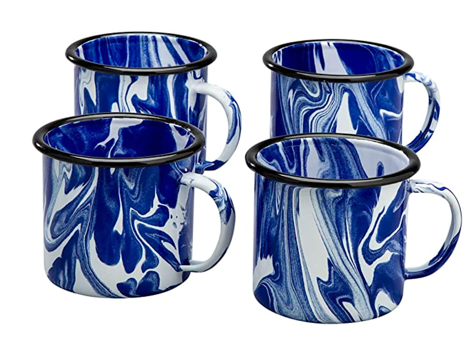 """<h3>Enamelware Marble Mug</h3><br>The easiest way to elevate your cramped kitchen space is one blue marble mug away.<br><br><strong>Fox Valley Traders</strong> Blue Marble Enamelware Mugs, Set of 4, $, available at <a href=""""https://amzn.to/3CZGSKp"""" rel=""""nofollow noopener"""" target=""""_blank"""" data-ylk=""""slk:Amazon"""" class=""""link rapid-noclick-resp"""">Amazon</a>"""
