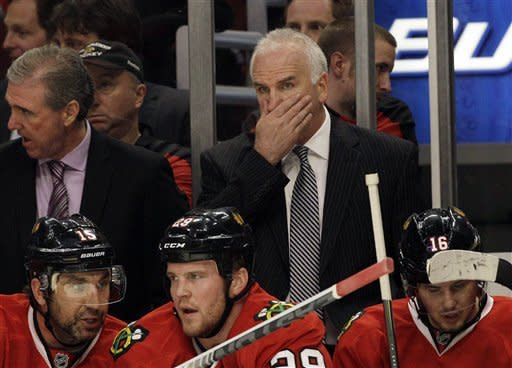Chicago Blackhawks head coach Joel Quenneville wipes his face as he watches his team during the first period of Game 6 of an NHL hockey Stanley Cup first-round playoff series against the Phoenix Coyotes in Chicago, Monday, April 23, 2012. (AP Photo/Nam Y. Huh)