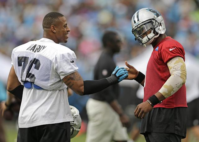 Carolina Panthers' Cam Newton, right, greets Greg Hardy during an NFL football practice at the team's Fan Fest in Charlotte, N.C., Friday, July 25, 2014. (AP Photo)