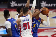 Denver Nuggets guard Shaquille Harrison (3) is defended by Detroit Pistons guard Deividas Sirvydis (91) and guard Saben Lee during the first half of an NBA basketball game, Friday, May 14, 2021, in Detroit. (AP Photo/Carlos Osorio)