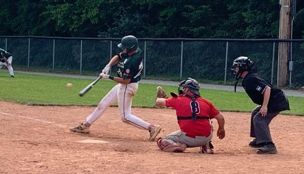 Charlottetown's Josh Myers swings at a pitch against the Saint John Alpines on Saturday. (Shane Ross/CBC - image credit)