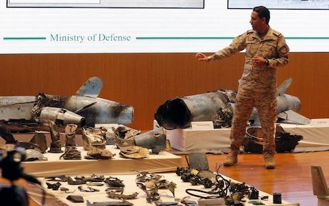 Saudi Defense Ministry spokesman Colonel Turki Al-Malik addresses a press conference next to the remains of the missiles allegedly used in the attack against Aramco oil facility - Credit: STRINGER/EPA-EFE/REX